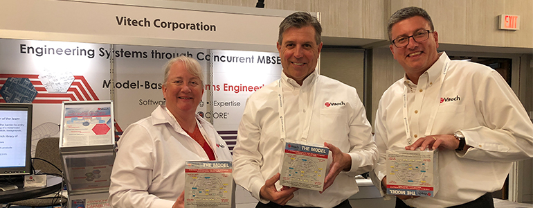 Ron Kratzke with colleagues at Vitech booth