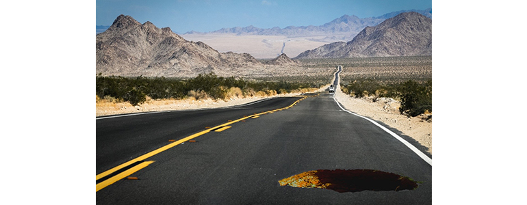 road with a pothole