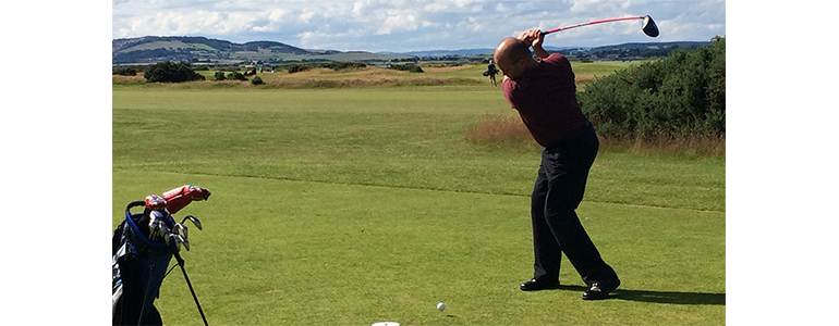 Steve Cash golfing at Balgove Course in St. Andrews, Scotland
